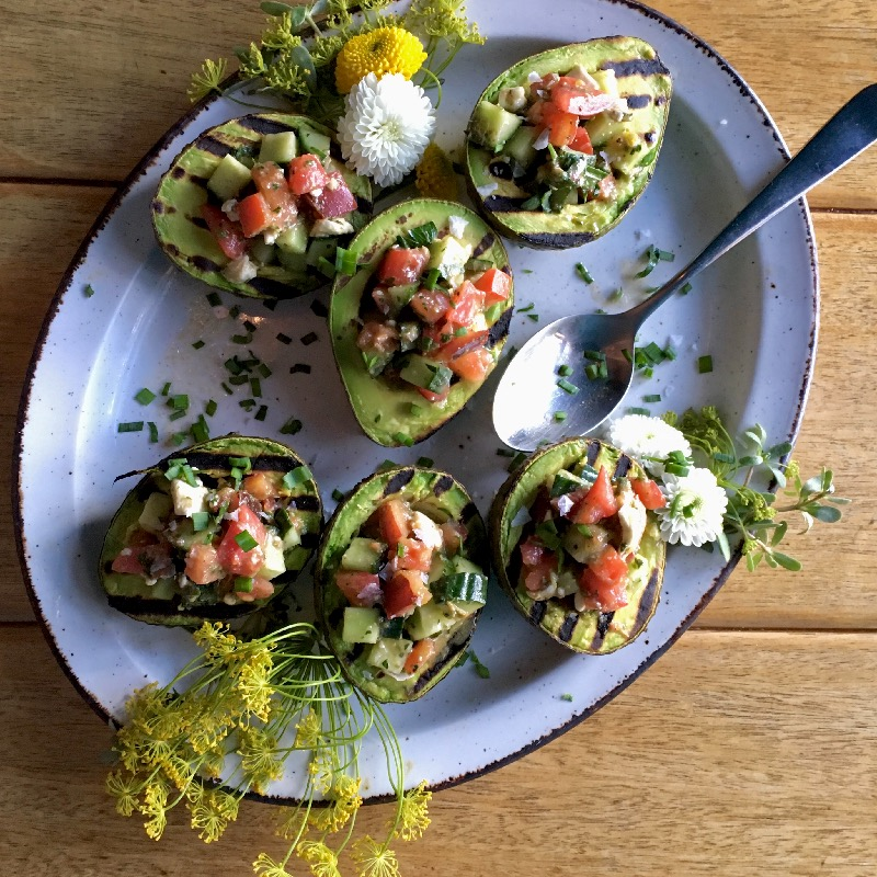 Grilled Avocados Stuffed with Cured Citrus Salmon, Early Girl Tomato & Japanese Cucumber Salad by Private Chef Brenda on Table at Home