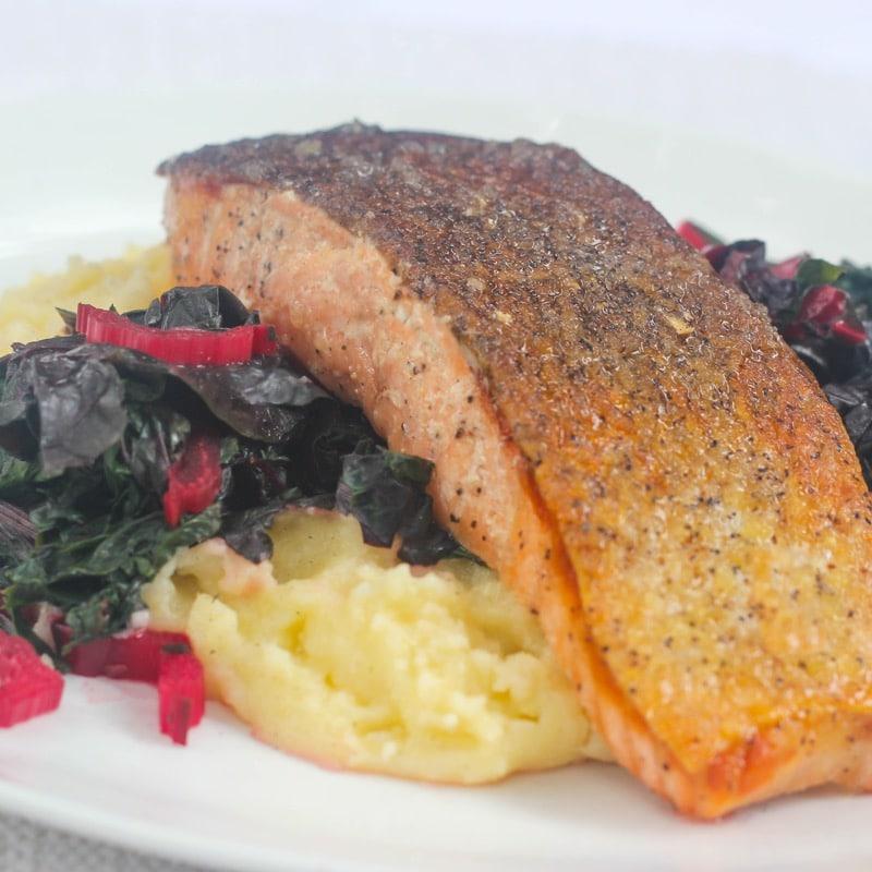 Seared salmon w/ rainbow Swiss chard & creamy polenta