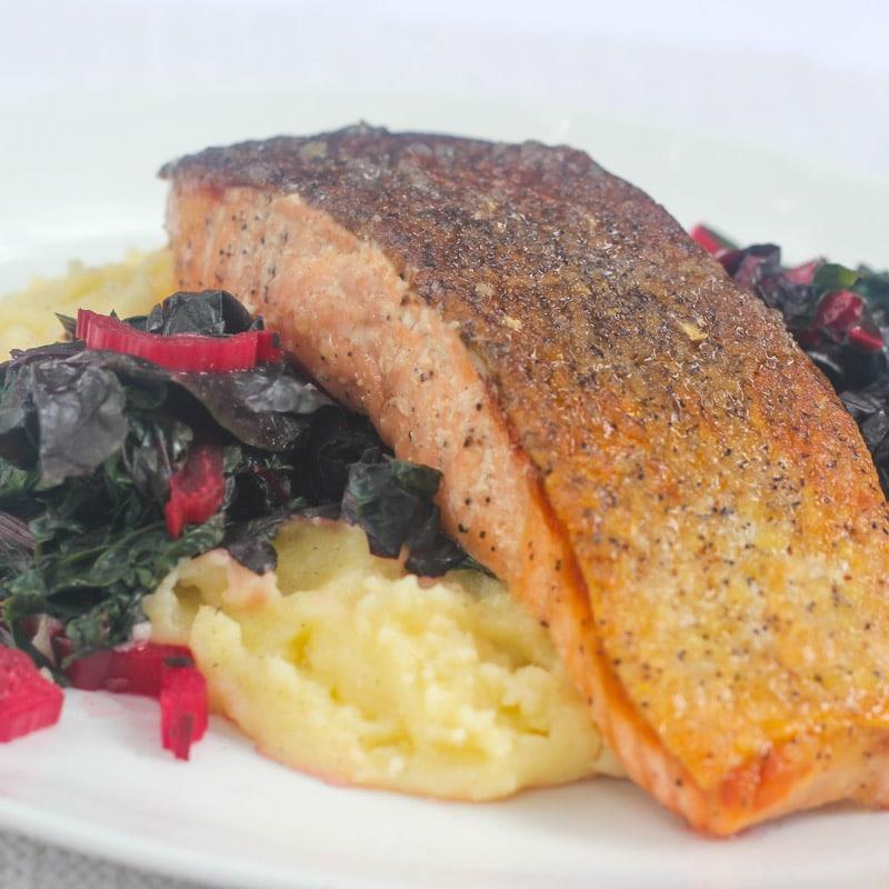 Pan seared salmon w/ rainbow swiss chard & creamy polenta