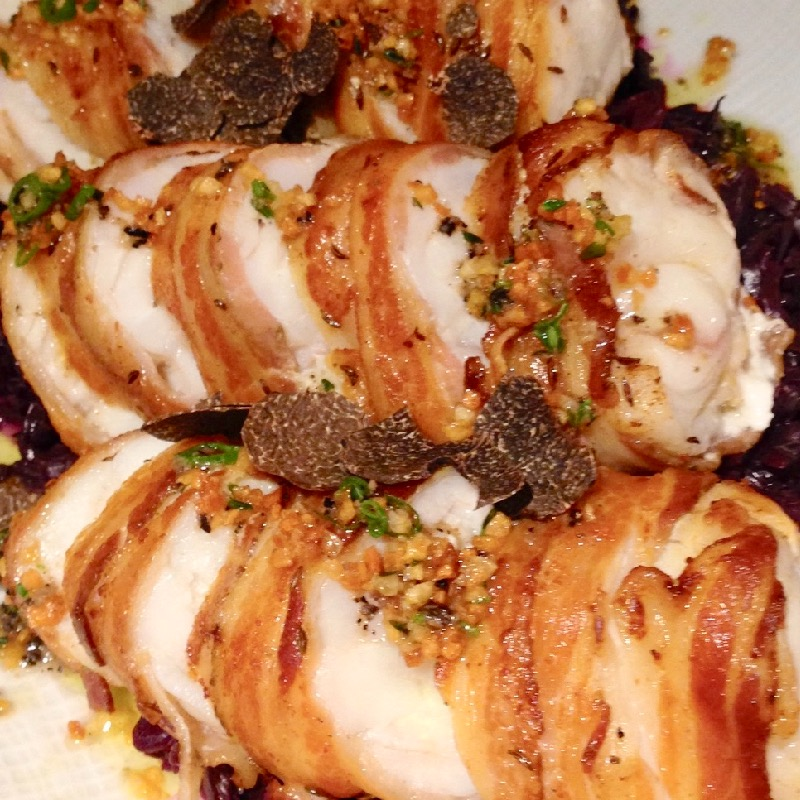 Pancetta wrapped monkfish with braised red cabbage