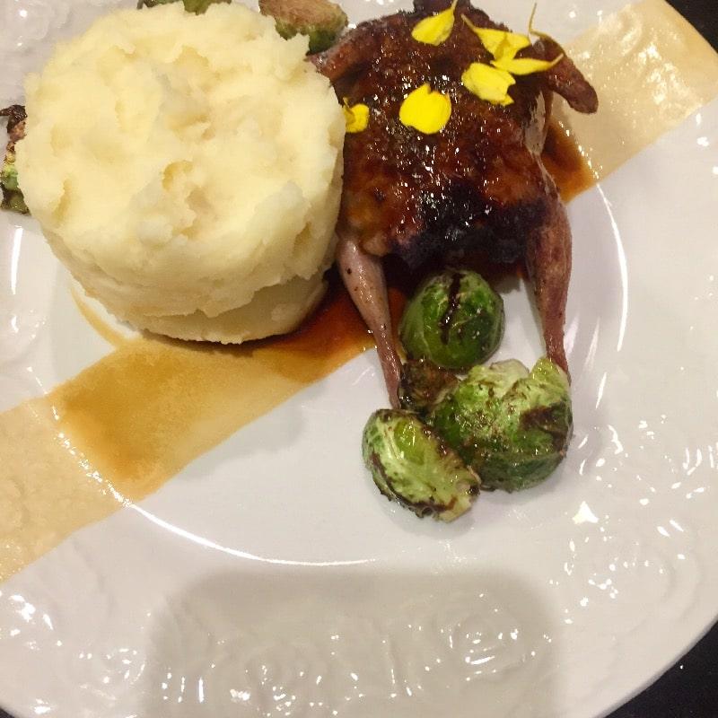 Pan seared quail stuffed with turkey sausage